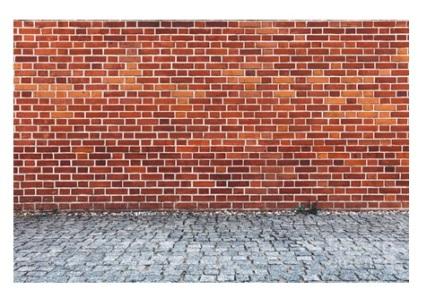 retro-red-brick-wall-and-cobblestone-pavement-michal-bednarek